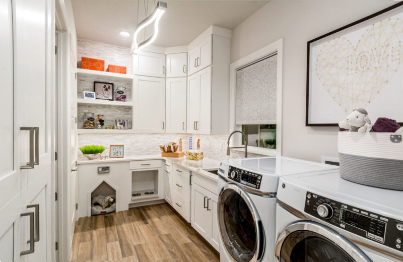 Award winning 55+ model home laundry room with pet storage and built in water bowl in Florida.