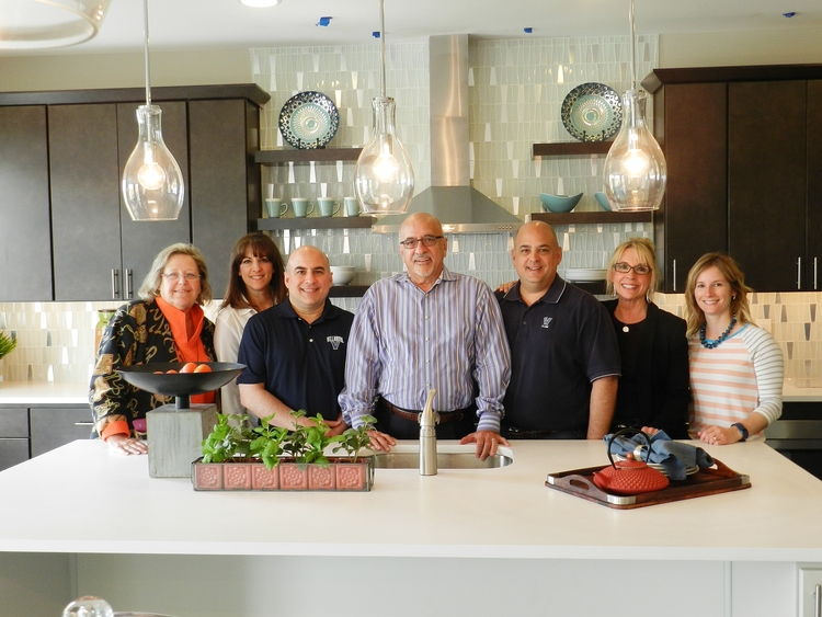 Group photo in kitchen with 6 professionals; 3 builders; 3 designers