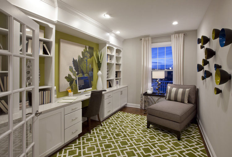 Fabulous flex space with built-ins, desk and seating area. Accented with blue and green.