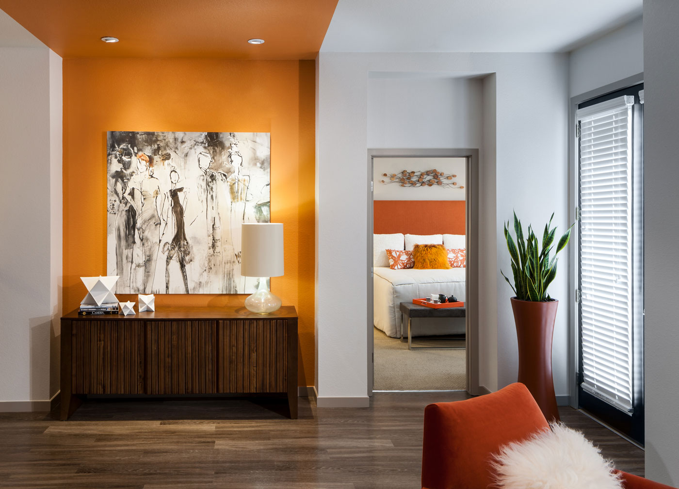 Luxury apartment merchandised with high-end finishes orange accents, and contemporary art in Englewood, Colorado.