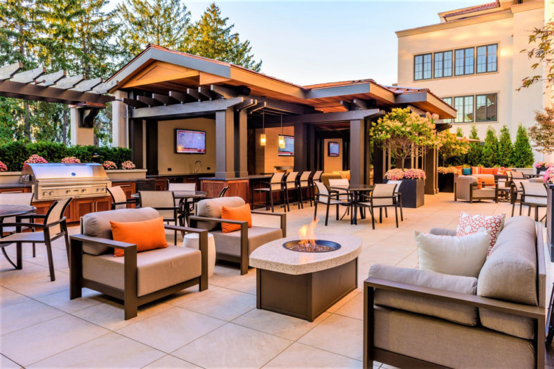 Large outdoor amenity area with bar, grill, fire pit, with variety of welcoming seating options in New York.