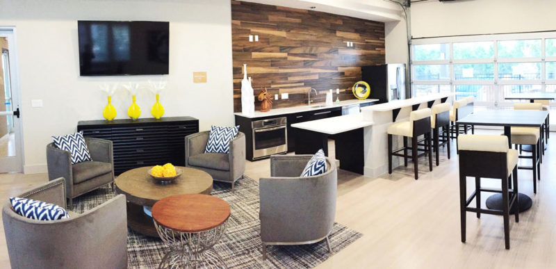 Modern multifamily clubhouse with cozy gathering space, bright finishes and overall sleek look in Texas.