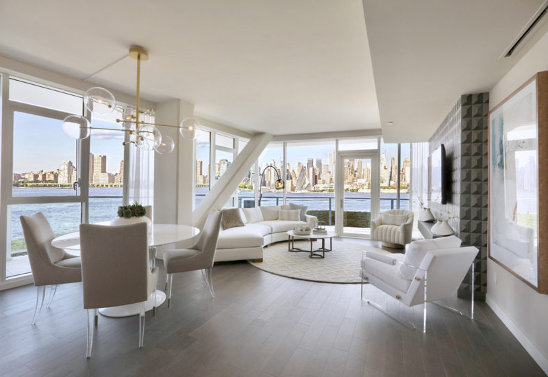 Upscale condo with breathtaking view of NYC skyline elegantly merchandised with white modern design in New Jersey.