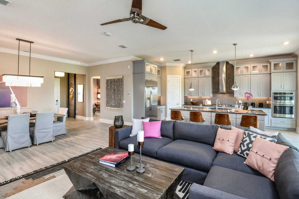 Model home with open floor plan, modern kitchen and merchandised with a contemporary bohemian flare in Florida.