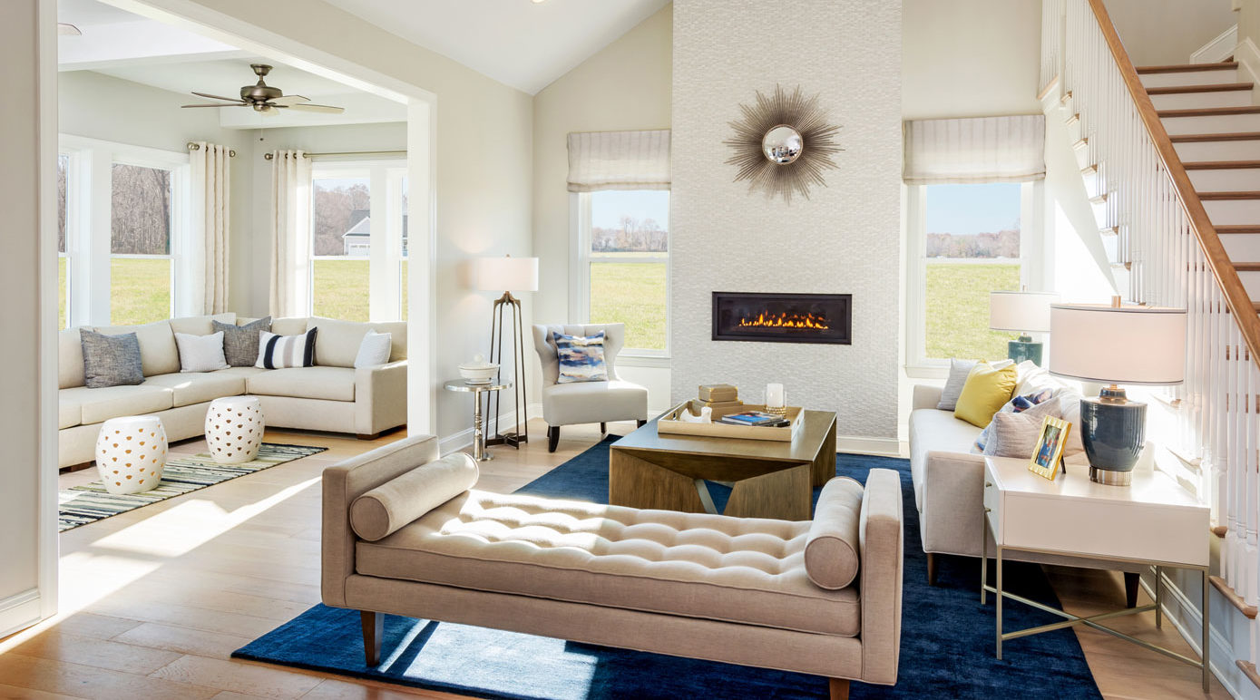 Light furnishings accentuate the brightness of room and compliment dark rug in 55+ buyer model in Delaware.