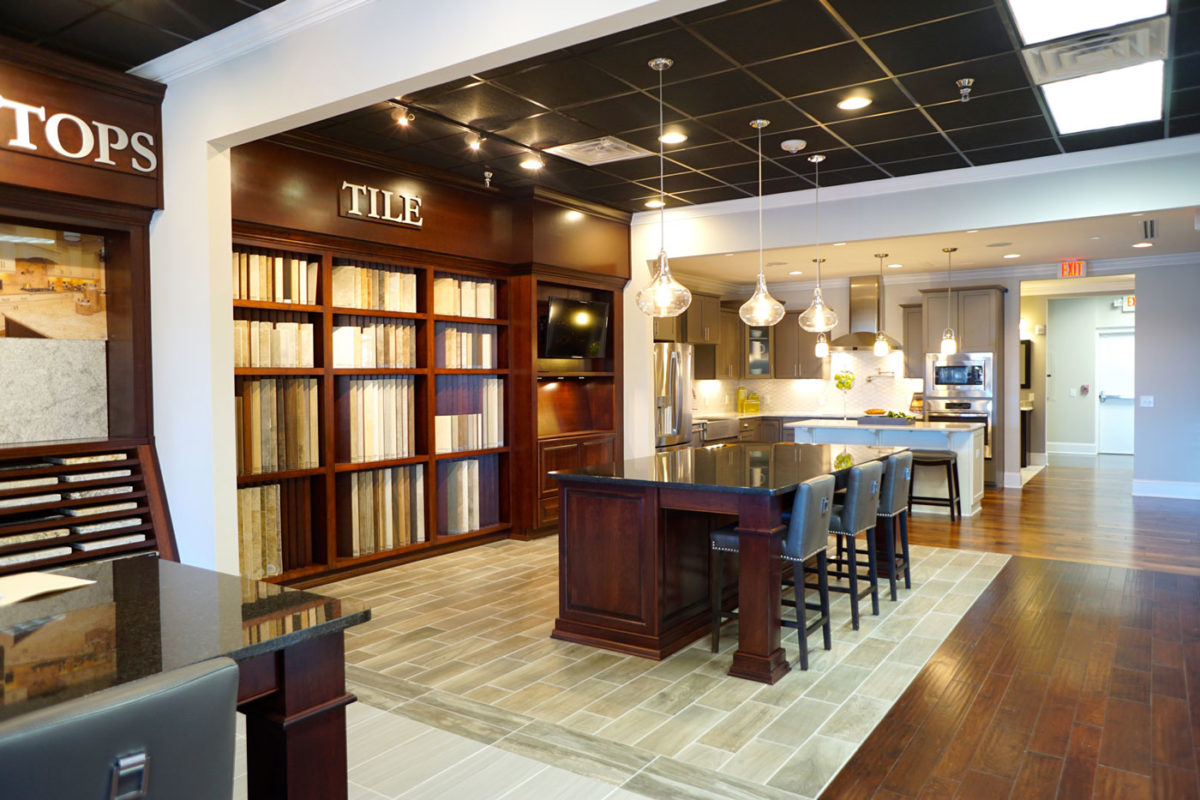 Design center with stunning dark wood floors and finishes showcasing tile and countertop options in North Carolina.