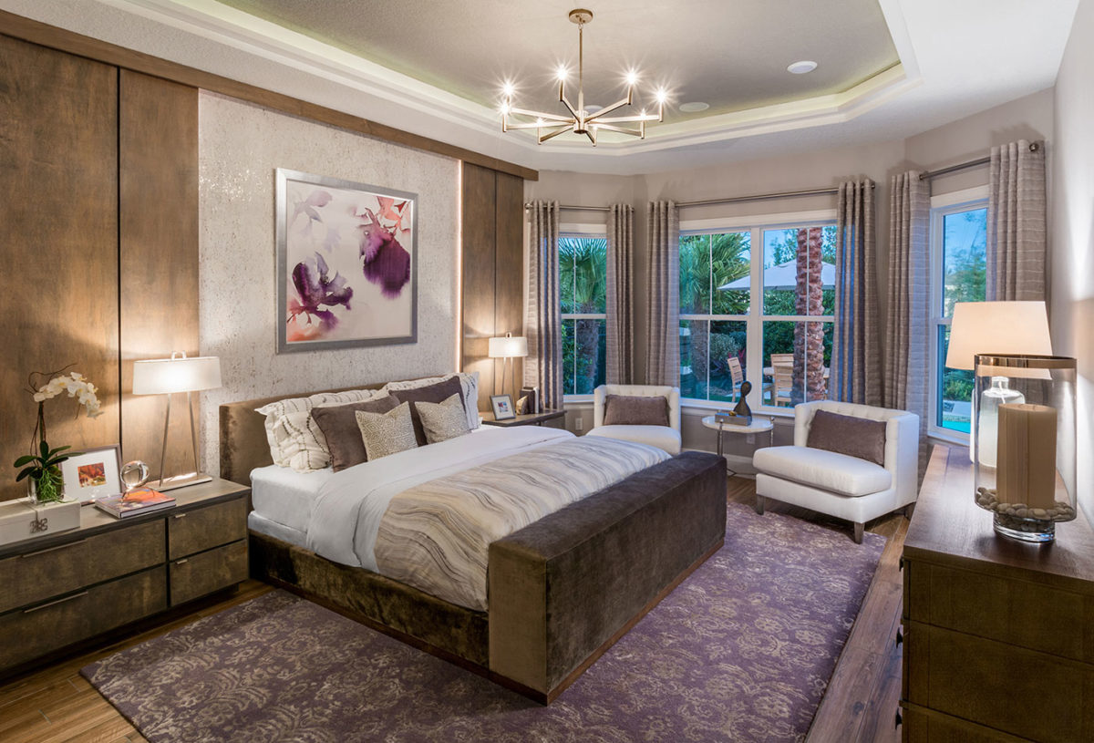 Master suite in award-winning model home for 55+ buyer merchandised with suede finishes and purple accents in Florida.