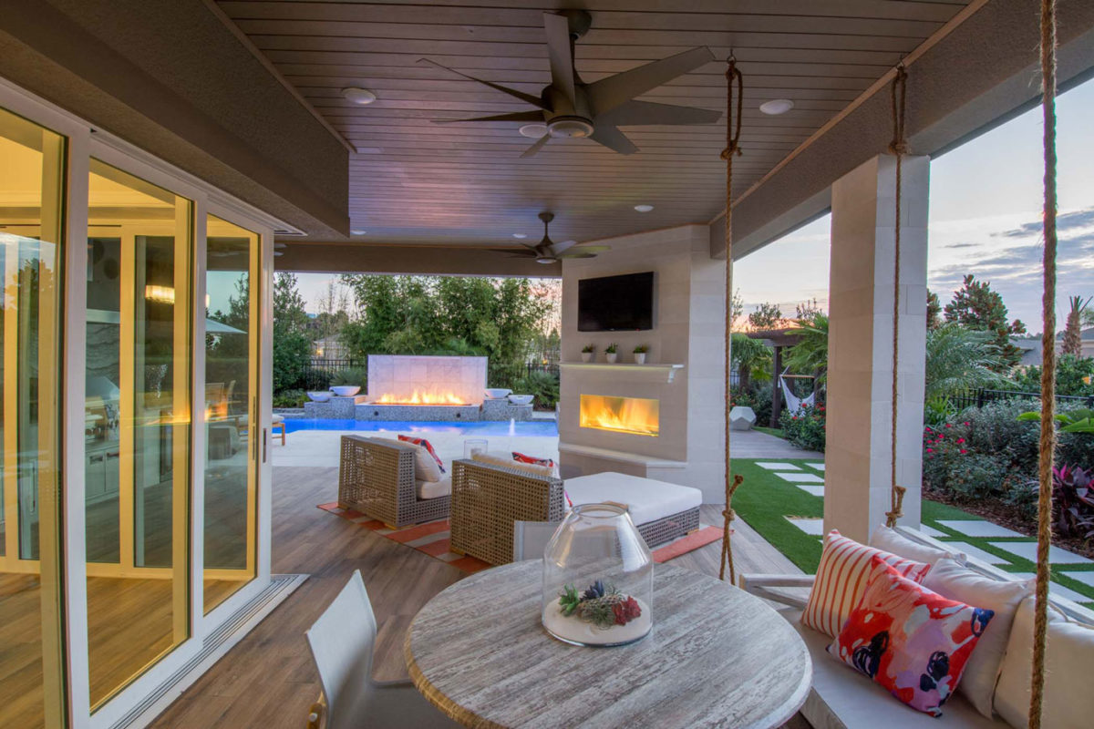 Gorgeous outdoor living space merchandised with a variety of comfortable and classy seating options in boomer buyer/55+ model home in FL.