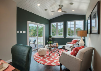 Cozy sitting area with green accented walls, meticulously merchandised finishes in Bensalem, Pennsylvania model home.