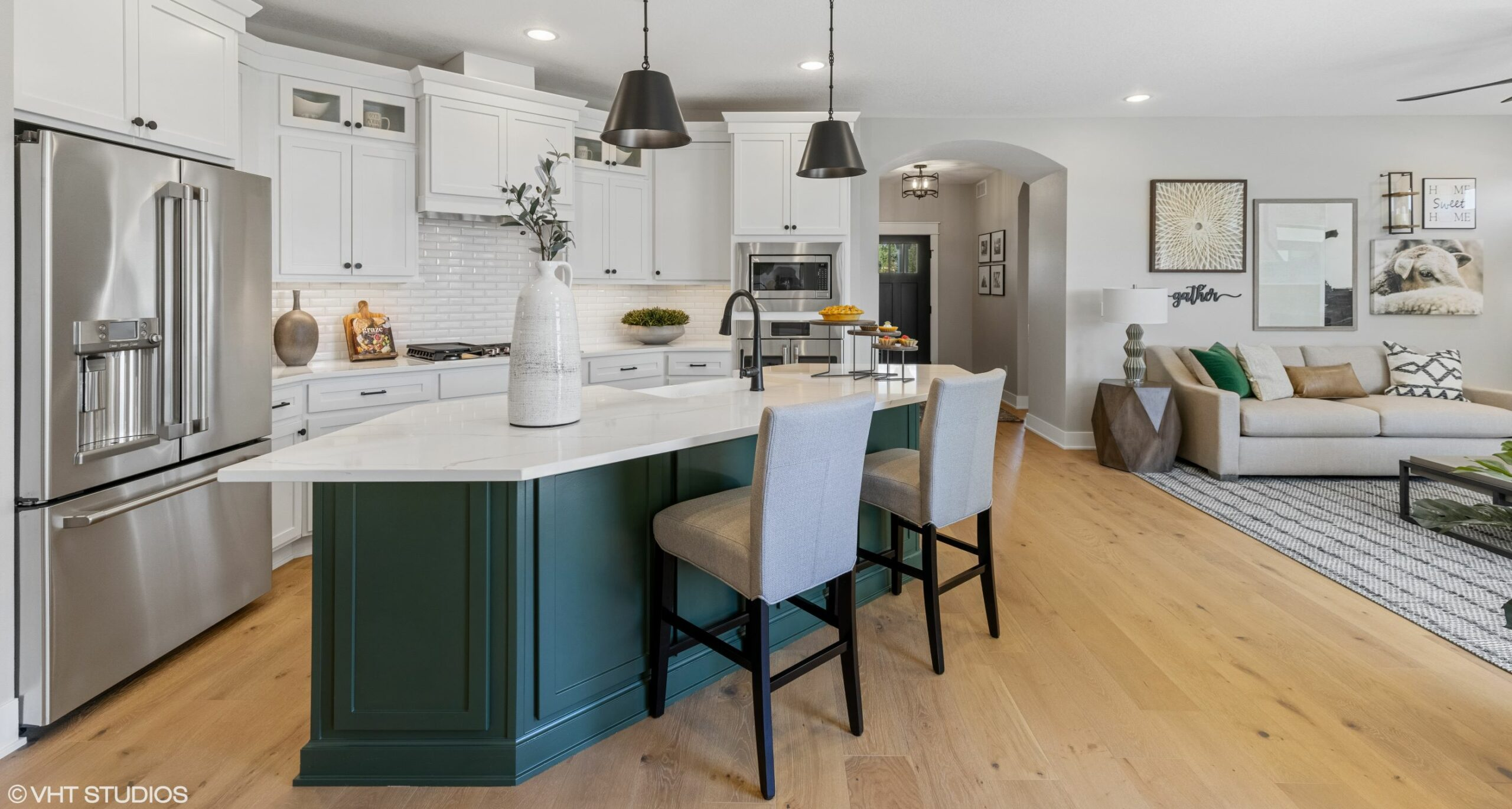 Bright open floor plan connects kitchen to great room in modern farmhouse model home in Ames, IA.